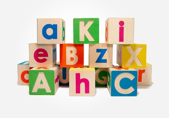 Wooden ABC blocks like these make teaching the alphabet way more fun! They also make awesome #giftsforkids