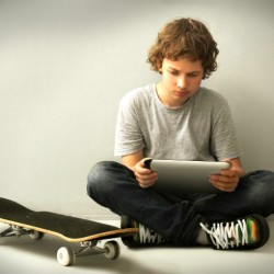 11 year old boy with skateboard
