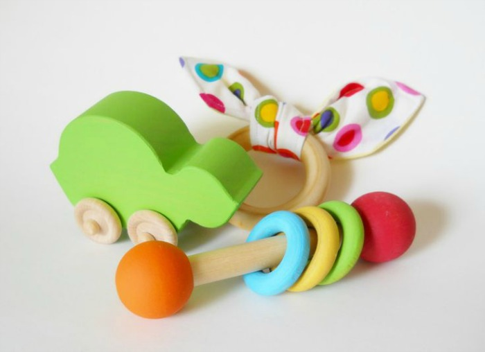 Gift Sets for Babies: Handmade, wooden toys like these make a sweet baby shower or christening gift for babies.