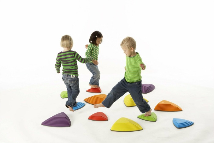 The kids would have a blast stepping and jumping over imaginary hot lava with these brightly colored riverstones.