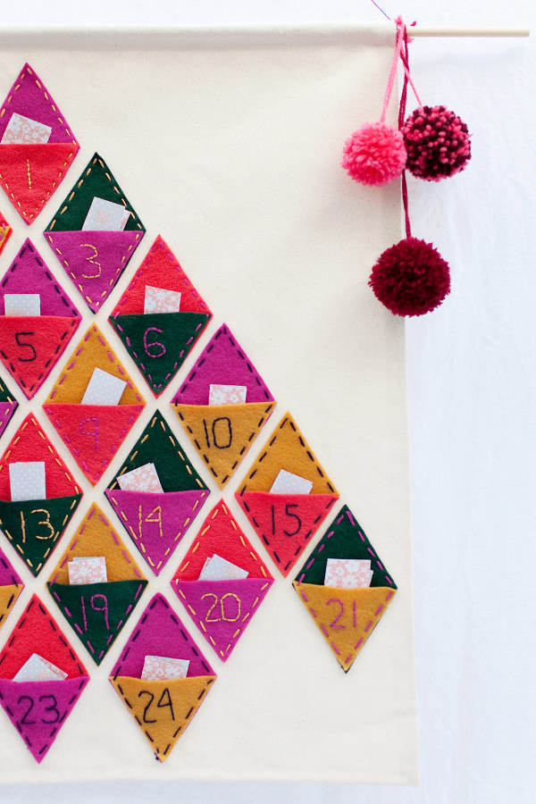 How many sleeps left until Christmas? 11 stylish DIY advent calendars to help you start the countdown the Christmas. Felt advent calendar via Tell, Love and Party.
