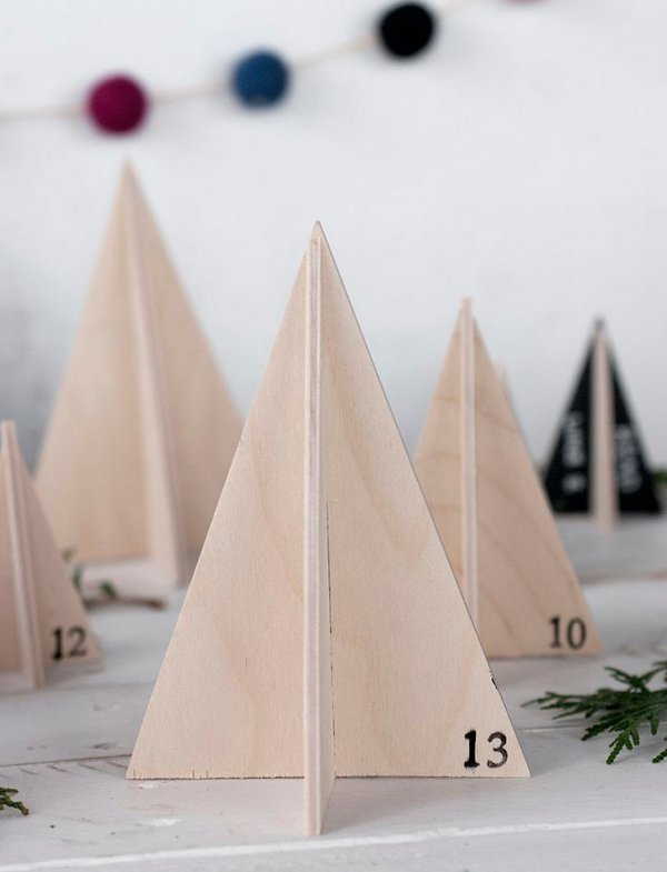 How many sleeps left until Christmas? 11 stylish DIY advent calendars to help you start the countdown the Christmas. Wooden tree advent calendar via A Merry Thought