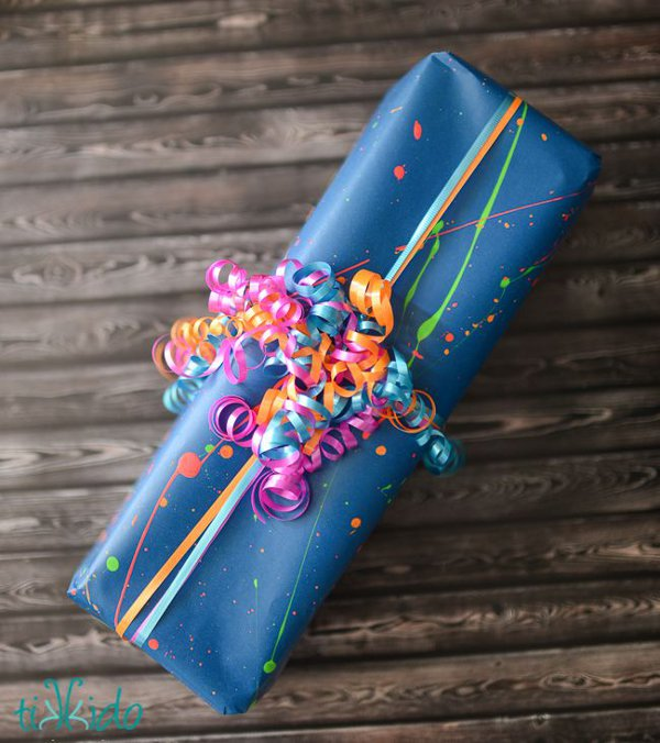 Make your own gift wrap - neon splatter paint gift wrap