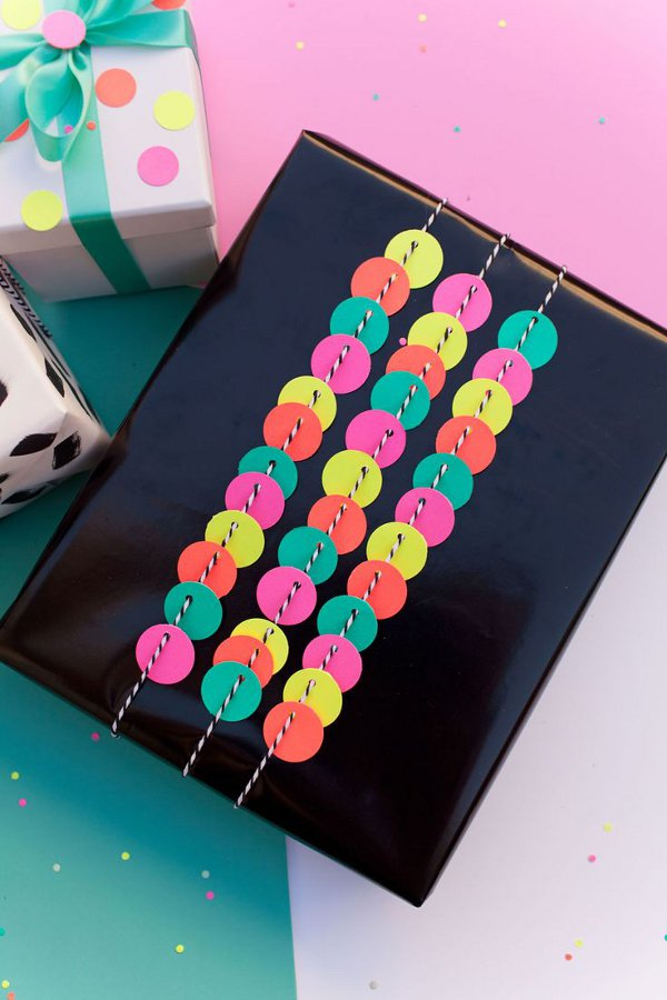 Make your own gift wrap with kids - punch hole gift wrap