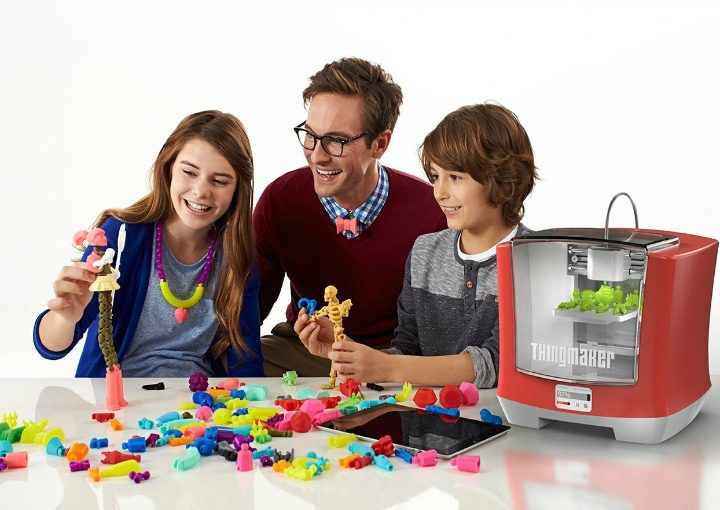 Family playing with ThingMaker 3D Printer