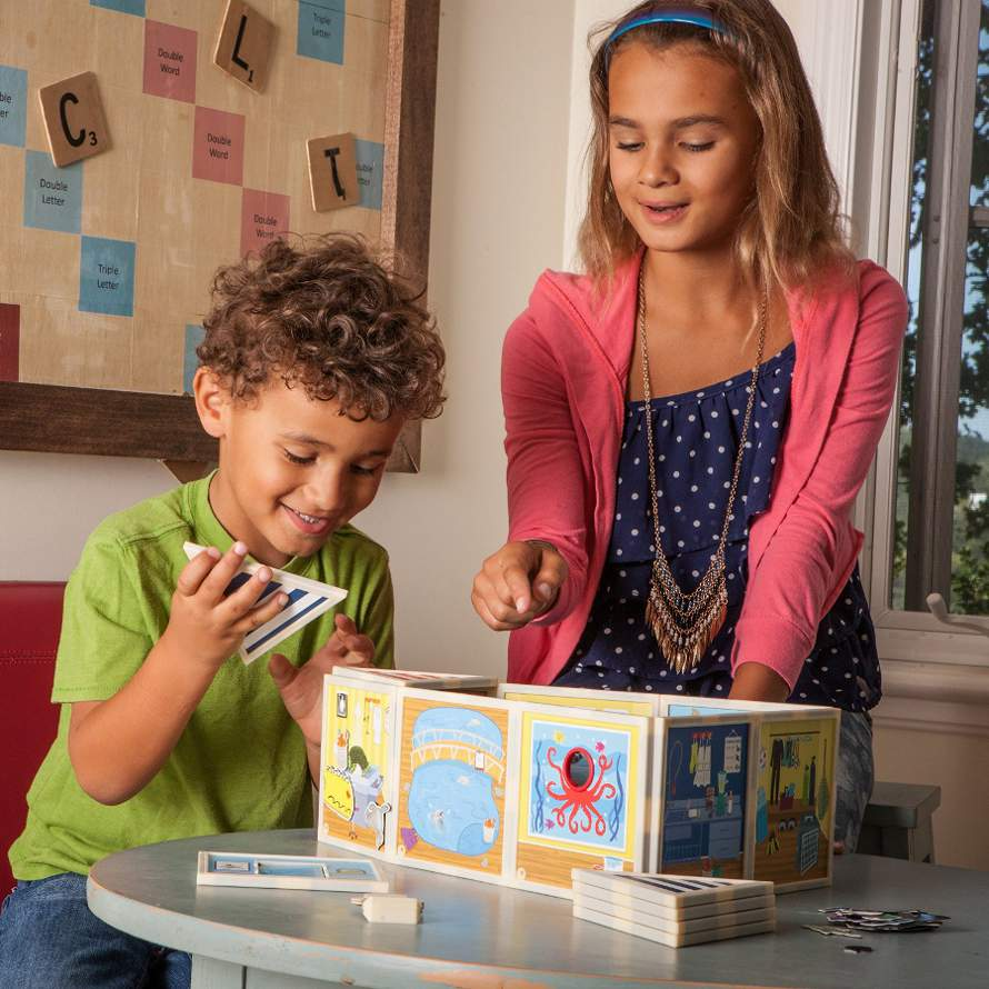 Build and Imagine magnetic dollhouse kit - boy and girl playing with kit