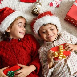 christmas toy ideas 2017 - girl and boy wearing santa hats